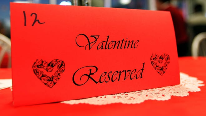 A table reservation is seen inside a restaurant during a Valentine's Day dinner