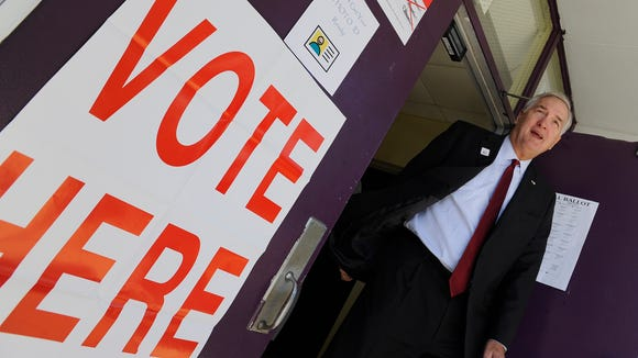 Attorney General Luther Strange leaves his polling place, Georgia Washington Middle School in Pike Road, Ala., after voting on Tuesday November 4, 2014. ,