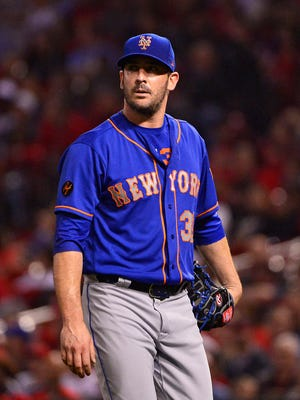 Matt Harvey walks off the Busch Stadium mound after giving up a go-ahead run in his relief appearance Tuesday.