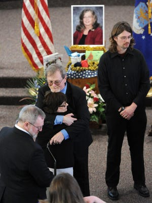 Husband Christopher Nye, center and his son, Bart (Gwen) Nye, right, greet family and friends during a memorial service held Saturday, Feb. 27, 2016, for Mary L. Nye, at Immanuel Lutheran Church in Bridgman, Mich. Nye was one of six people killed in the Feb. 20, 2016, shootings in Kalamazoo, Mich.