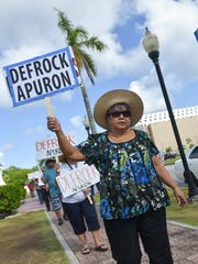 "Protesters convene at the Dulce Nombre de Maria Cathedral Basilica with ""Defrock Apuron"" signs in Hagåtña in this June 4, 2017, file photo."