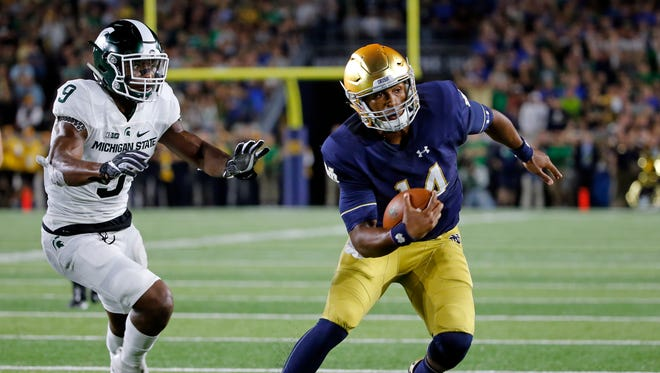 Notre Dame quarterback DeShone Kizer heads to the end zone in front of Michigan State safety Montae Nicholson for a touchdown during the first half of an NCAA college football game Saturday, Sept. 17, 2016, in South Bend, Ind.