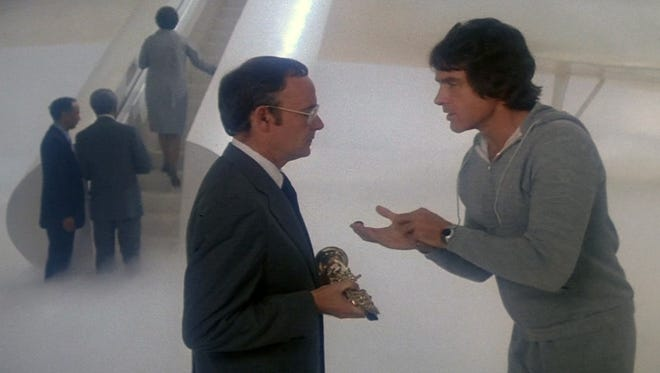 """Warren Beatty (right) argues with his escort (Buck Henry) in heaven in the 1978 film """"Heaven Can Wait."""""""