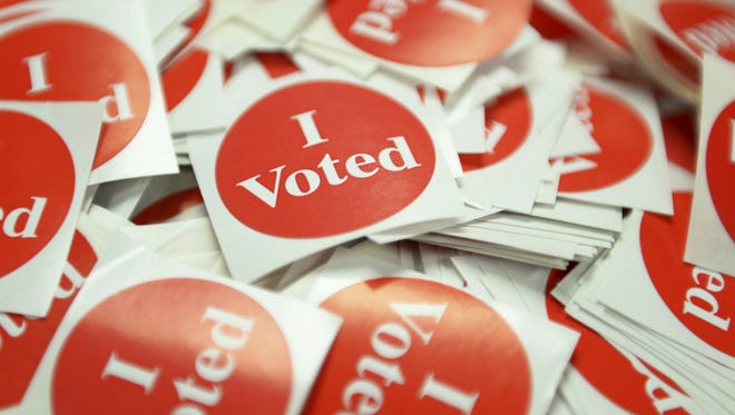 """""""I Voted"""" stickers sit for voters upon dropping off their absentee ballot at a polling place in St. Paul in 2016."""