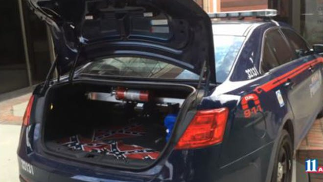 Confederate flags that were placed on the grounds of Ebenezer Baptist Church in Atlanta on Thursday, July 30, 2015, sit inside a police car. Authorities are investigating after they were found near the church and civil rights center named after Martin Luther King Jr.
