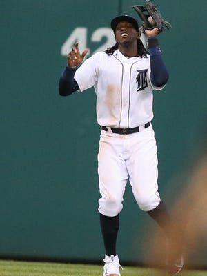 Tigers centerfielder Cameron Maybin catches a fly ball by Twins first baseman Joe Mauer during the third inning Tuesday at Comerica Park.