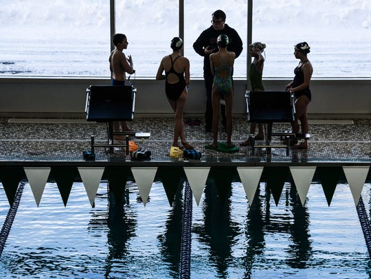 Members of the YMCA swim team get ready for practice