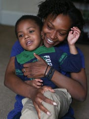 Namire Wanamaker and her son Khamire, 3. Namire graduated