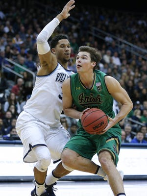 Notre Dame Fighting Irish guard Steve Vasturia (32) moves to the basket against Villanova Wildcats guard Josh Hart (3) during the first half of the first game of the Never Forget Tribute Classic at Prudential Center.