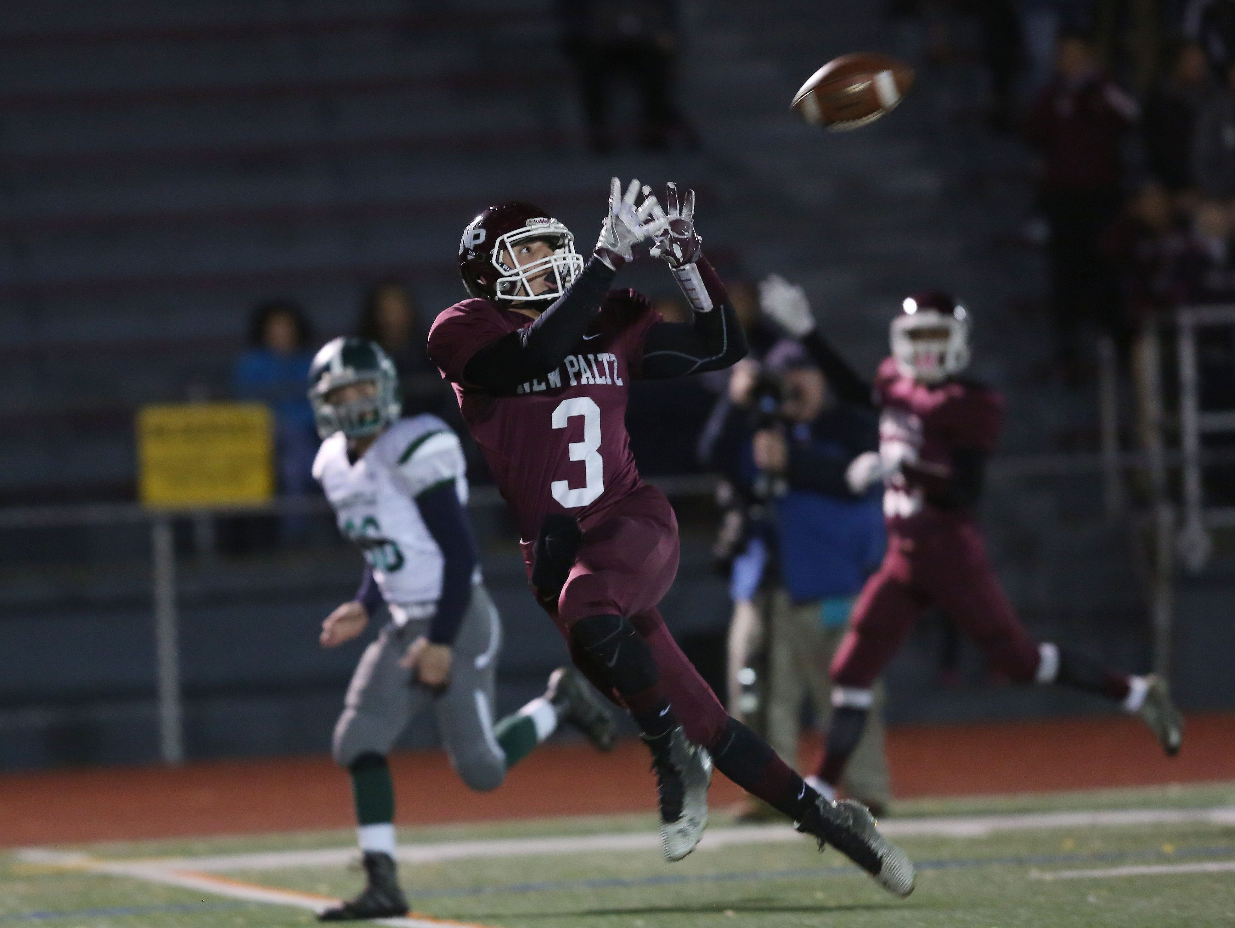 New Paltz's Joseph DiMarco (3) catches a first quarter touchdown pass against Pleasantville in the Class B regional semifinal football game at Dietz Stadium in Kingston Nov. 11, 2016