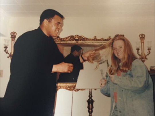 Emily Patterson of Battle Creek meeting Muhammad Ali in the early 1992.