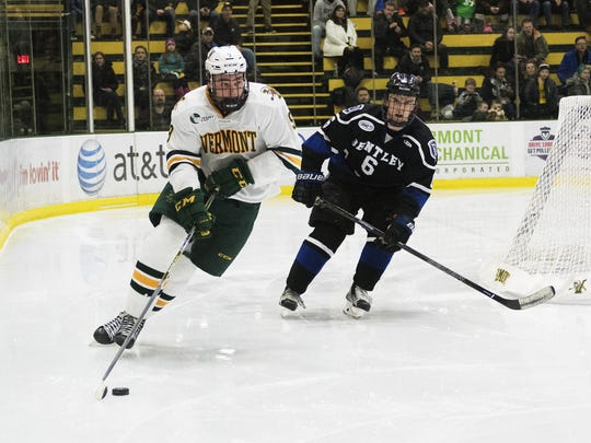 Catatmounts forward Brian Bowen (9) skates behind the net with the puck during the men's hockey game between the Bentley Falcons and the Vermont Catamounts at Gutterson Fieldhouse on Saturday.