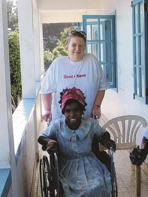Good News volunteer Nicole Hollander of Schofield escorts in 2006 a Missionaries of Charity resident to the beach for a sea bath.