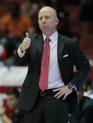 After wearing glasses during games last season, University of Cincinnati basketball coach Mick Cronin is going with contact lenses this year.