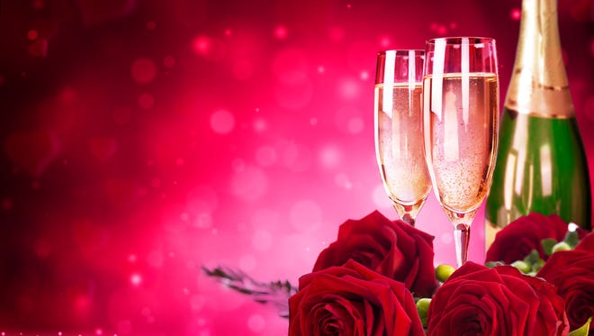 composition  with champagne, flutes and red roses