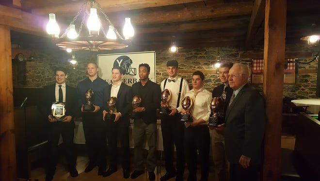 Roy Robbins, right, of the Quarterback Club of York, stands next to some of those honored at Monday's banquet. They are, from left: Steven Dunczyk, Owen Jacobs, Daniel Yokemick, Jakkar Kinard, Ben Igo, Teague Hoffman and Sam Emig.
