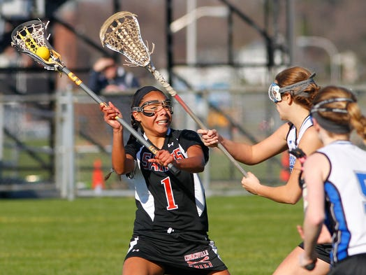 Churchville-Chili's Cheyenne Clark, left, gets a shot off against Brockport's Kirsten Craig, center, and Tori Penders.