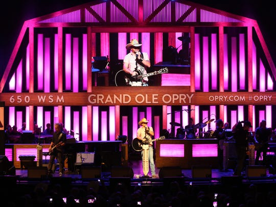 Jason Aldean performs during the Opry goes pink show