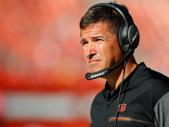 """New Cincinnati Bengals offensive coordinator watches from the sideline in the fourth quarter of the NFL Week 4 game between the Cleveland Browns and the Cincinnati Bengals at FirstEnergy Stadium in downtown Cleveland on Sunday, Oct. 1, 2017. The Bengals tallied their first win of the season, 31-7, in the """"Battle for Ohio"""" game."""