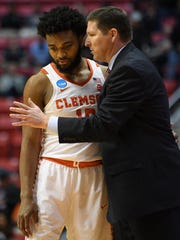Clemson coach Brad Brownell speaks with guard Gabe