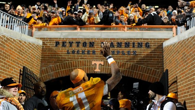 Tennessee quarterback Joshua Dobbs (11) waves to fans as he leaves the field for the final time after the Volunteers celebrated their 63-37 win over Missouri at Neyland Stadium on Saturday, Nov. 19, 2016.