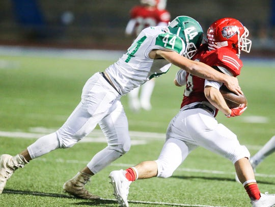 Wall's Sterling Guy tackles Jim Ned's Riley Perry during