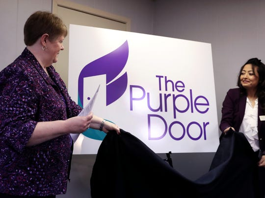 Frances Wilson (left) and Zehra Surani reveal the new name of the Women's Shelter of South Texas, The Purple Door, on Tuesday, Jan. 16, 2018, on the 40th anniversary of the organization. The new name better reflects the offerings of the organization, which is more than a shelter. It includes a variety of services for individuals that are not staying in the shelter, said Wilson, executive director of The Purple Door.
