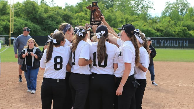 Plymouth's varsity girls softball team hoists the Division 1 district trophy.