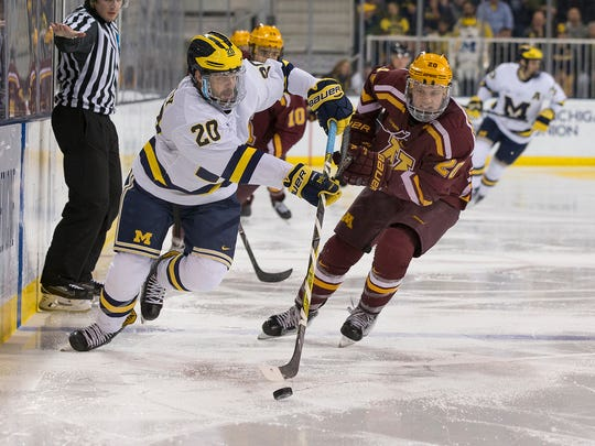 Cooper Marody (left) of Brighton is the leading scorer for the University of Michigan with nine goals and 22 assists in 24 games.