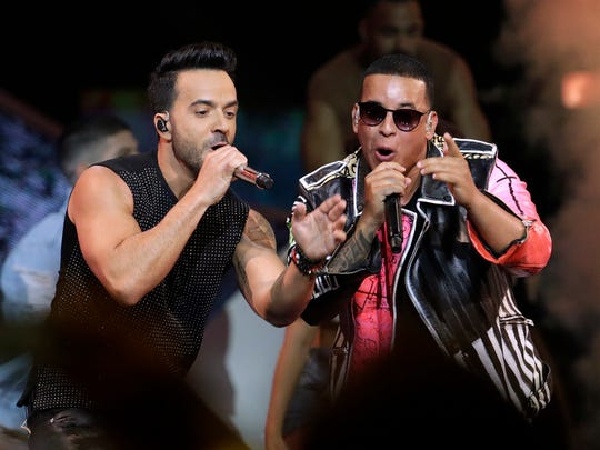 Luis Fonsi, left, and Daddy Yankee perform during the