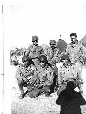 Arthur Merkley (middle back row) with his squad. Merkley served in the 95th Division. He was killed Nov. 12, 1944 near Metz France. He was 32.