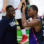 USA's Kevin Durant reacts with Draymond Green during the gold medal game between Serbia and USA in Rio de Janeiro on Aug. 21.