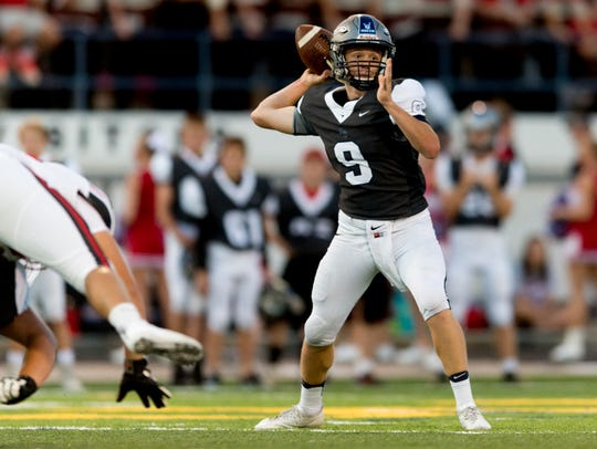 Anderson County's Stanton Martin (9) looks for a pass