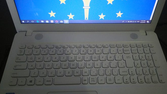 While opponents Richard Moss and Rep. Larry Bucshon meet voters, Rachel Covington runs her campaign from this keyboard -- with Japanese symbols -- in Tokyo.