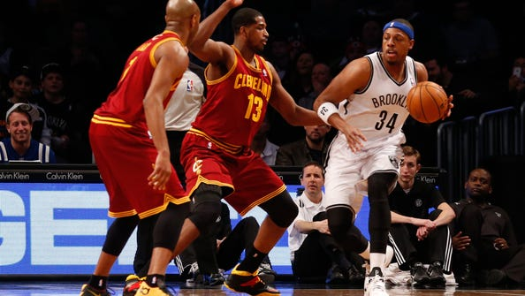 Brooklyn Nets small forward Paul Pierce begins to drive past Cleveland Cavaliers power forward Tristan Thompson during the first quarter at Barclays Center.