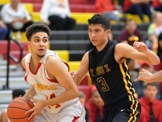 Centennial gaurd Cesar Molina looks to make a pass