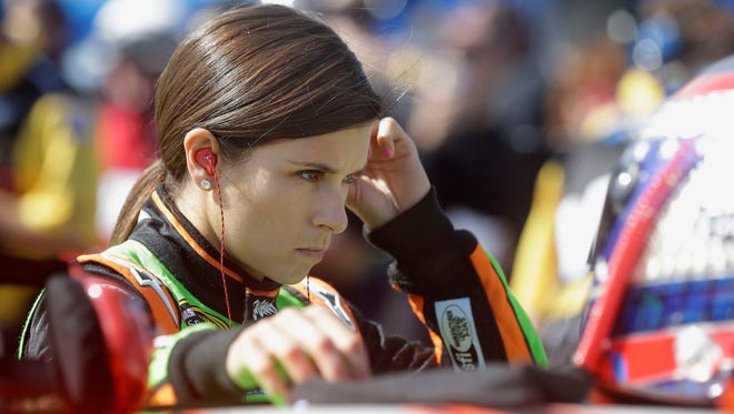 NASCAR Sprint Cup Series driver Danica Patrick prepares in the pits at Pocono Raceway before practice for Sunday's NASCAR Sprint Cup Series auto race in Long Pond, Pa., Friday, June 6, 2014.