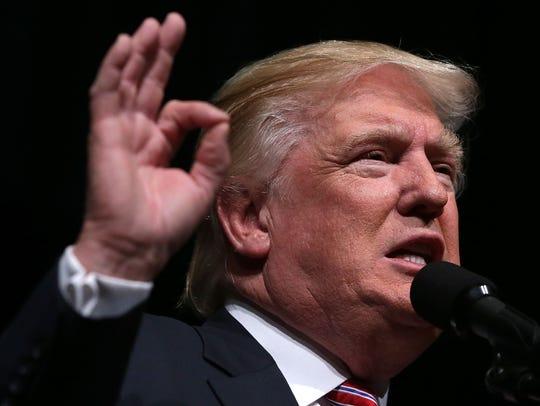 Republican presidential nominee Donald Trump speaks