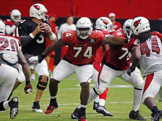 Arizona Cardinals offensive tackle D.J. Humphries (74) protects quarterback Carson Palmer (3) during training camp Monday, Aug. 1, 2016 in  Glendale,  Ariz.
