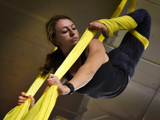 Holly Meyers during a Level 2 Aerial Silks class at