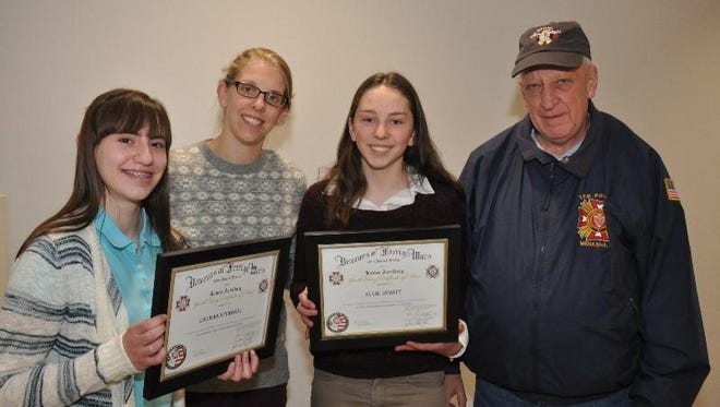 Three St. Mary Middle School eighth-grade students were honored in December for the essays they entered in the Annual National Patriot Pen contest sponsored by Nicolet Veteran of Foreign Wars Post 2126 Menasha. Pictured, from left, are Lauran Sturgell, Abby Weggel, teacher Ellie Dewitt and Post 2126 Commander Dave Mix. Not pictured is Ava Krema.