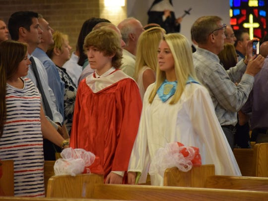 St. Joseph High School Class of 2016 graduates Brody Gallagher, 18, of Berlin, and Jenna Contrevo, 18, of Washington Township walk in the class processional.