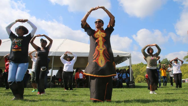 Anita Thompson (center) of Freehold Township participates in a Zumba session before the start of the 2014 African-American Arts and Heritage Festival at the PNC Bank Center in Holmdel.