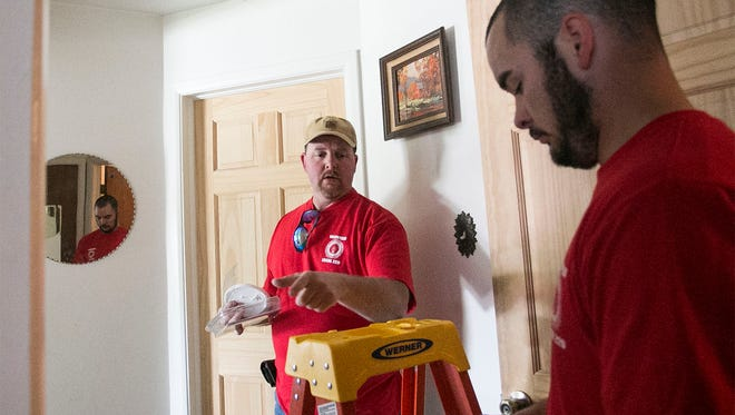 Electricians Ron Hilbert, left, of Littlestown, and Jared Grim, of Springettsbury Twp., install smoke detectors for a household on Fireside Rd., Saturday, April 23, 2016. Members of International Brotherhood of Electrical Workers (IBEW) Local 229 purchased over 300 smoke detectors, which was free of charge for residents in the Fireside neighborhood. Amanda J. Cain photo