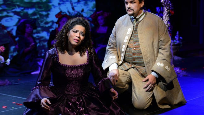 "In the Opera Naples production of ""Rappaccini's Daughter,"" Beatriz (Maria Laeititia) warns Giovanni (Samuel Hall) that she is poisonous to him."