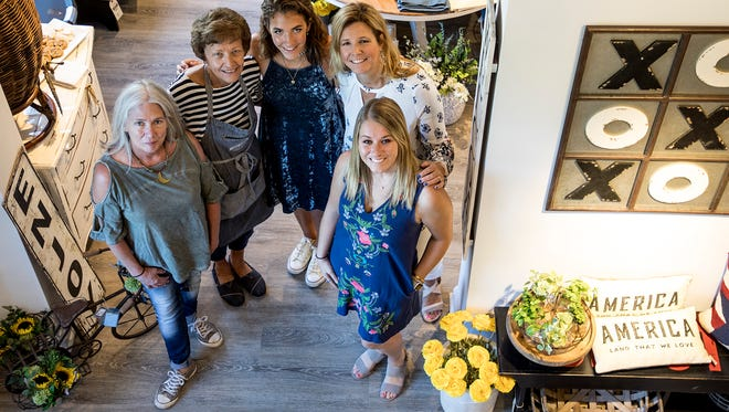 Michele Koester, owner of Michele's Real Deals on Home Décor,  poses for a photo in the new Real Deals location with her staff, Kim McPeek-Downs, Carol McPeek, Madison Koester and Britney Compton.