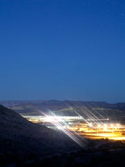 Lights from the Fort Pierce  Industrial Park shine in this file photo.