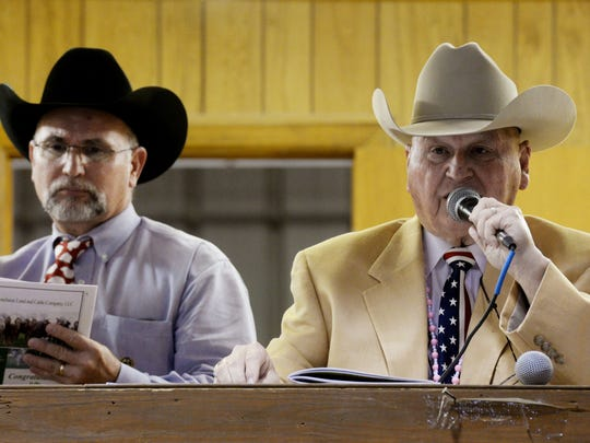 Jack Dillard, right, has been the auctioneer at the Louisiana State Fair Junior Livestock Auction since 1965. His son, lifelong auctioneer Jim Dillard (left), is on his second year with the auction.