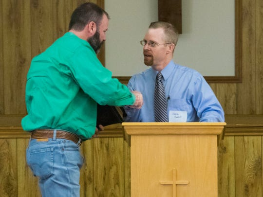 Jeremy Vincent, CEO of the West Texas Boys Ranch, accepts