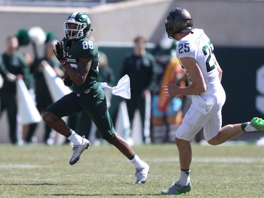 Michigan State receiver Trishton Jackson runs while